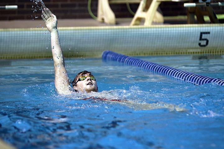 Sophomore Connor Bullard swims backstroke at practice to train for the teams meet against Wheaton on February 3. Photo by Tony Dzik.