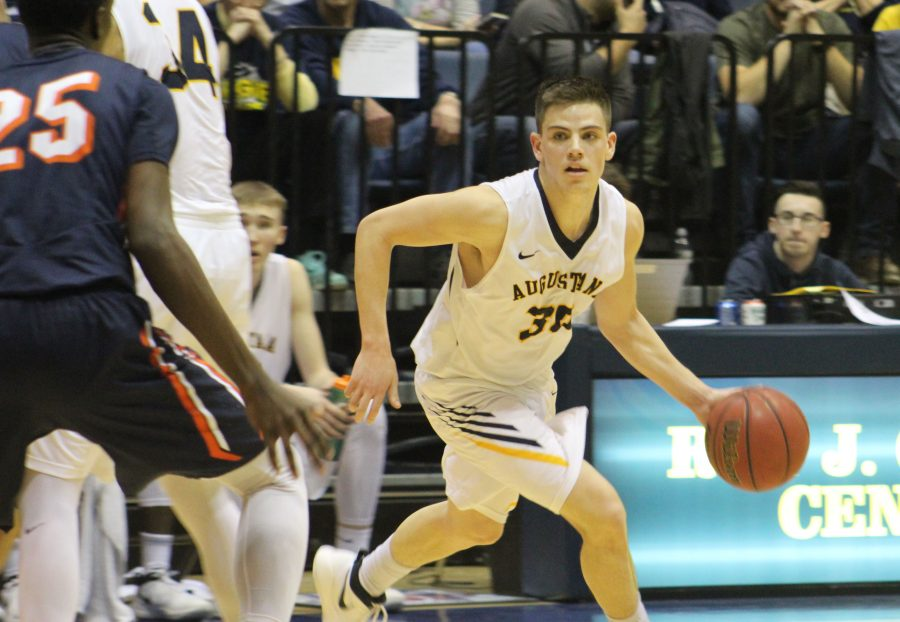 Augustana Viking Dylan Sortillo ('18) attempts to pass the ball to his teammates at the CCIW tournament against Wheaton. Photo by Maria Do.