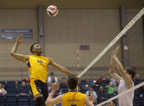 Joshua Richardson (21) spikes the ball against Judson players during the Vikings first ever home match in Augustana mens volleyball history. Photo by Kevin Donovan