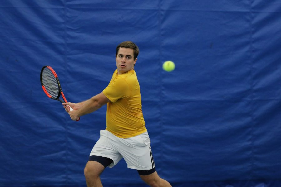 Senior Eric Pohl returns the serve from Illinois Tech. Augustana won with a score of 9-0.