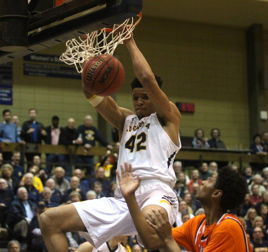 Augustana+Viking+Donovan+Ferguson+%2820%29+dunks+the+ball+during+the+NCAA+game+against+Greenville+on+Friday+night+at+the+Carver+Center.+Photo+by+Kevin+Donovan