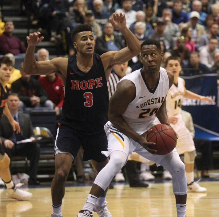 Augustana+Junior+Chrishawn+Orange+goes+up+against+a+Hope+College+player+during+the+NCAA+game+on+Saturday+night+at+the+Carver+Center.+Photo+by+Kevin+Donovan