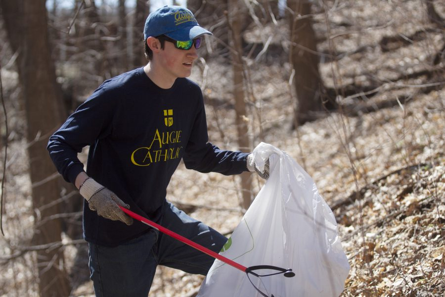 Sierra+Club+Vice+President+Ryan+Johnson+cleans+up+trash+in+the+ravine+area+by+Westerlin+on+Thursday.+Photo+by+Kevin+Donovan
