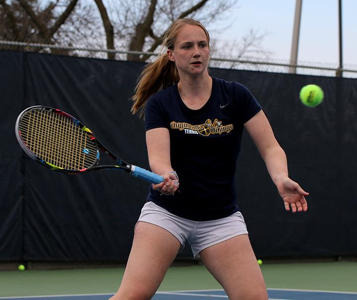 First-year+Annie+Timm+prepares+to+hit+a+forehand+to+her+opponents+during+her+number+two+doubles+match.+The+Augustana+womens+tennis+team+overall+lost+to+Luther+College+with+a+score+of+9%E2%80%938.+Photo+by+Tony+Dzik.