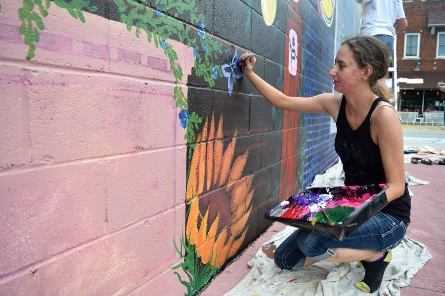 Artist+Alexandra+Shuck+paints+a+butterfly+on+Sunday%2C+July+22.+Though+normally+a+sketch+artist%2C+Shuck+has+found+beauty+and+fun+in+participating+in+community+mural+painting.+