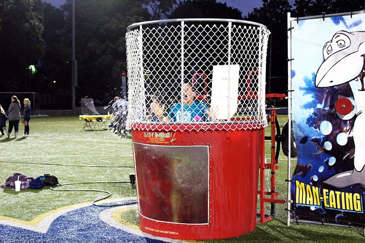 Lauren Endress is dunked in the water during the Sept. 8 carnival on the Lacrosse field. Photo by Christina  Rossetti.