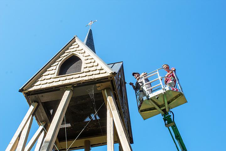 Doug Stevens and Ian Erickson of Creative Decorating Inc. paint the belltower.