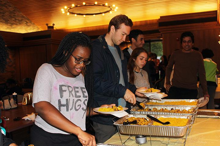 Augustana+College+students+serve+themselves+traditional+Middle+Eastern+food+at+the+Eid+Mubarak+dinner.+Photo+by+Alia+McMurray.