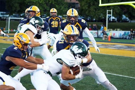 Augustana football players tackle the Wesleyan football players to prevent a touchdown. Photo by Christina Rossetti.
