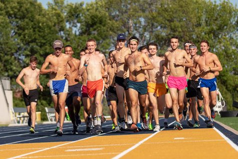 The Mens XC team does their warmup laps. Photo by Ian Murrin.