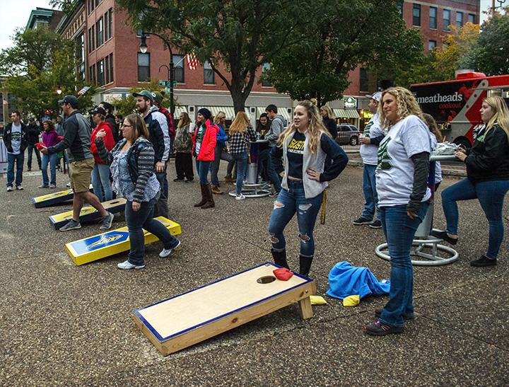 Students and parents take part in the bags tournament at Flip the District, on Saturday, Sept. 29.