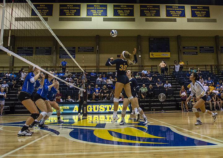 The Augustana womens volleyball team cut a ribbon before playing the first game on the new floor in the Carver Center. Photo by Emma Gannaway.