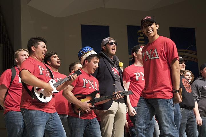 Rho+Nu+Delta+members+play+fake+guitars+and+sing+during+the+annual+homecoming+Sing+competition.+Photo+by+Brady+Johnson.