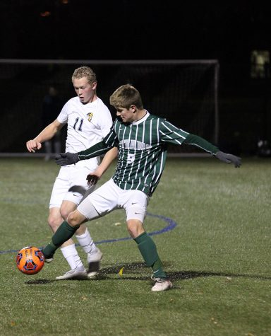 Augustana sophomore Chris Plantz  attempts to steal the ball from Luke Cangilla (#9) in their game against Illinois Wesleyan on October 10. Vikings won 1-0.