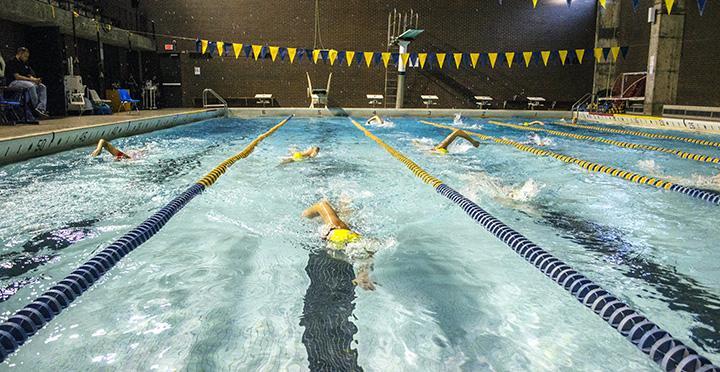 (Center) Marissa Jaskae swims a 50 of freestyle, on Tuesday, Nov. 27. Photo by Emma Gannaway.
