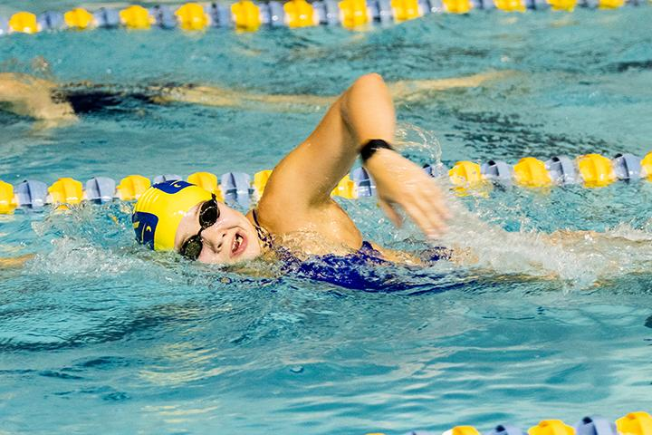 First-year Lauren Raike warms up in the pool at the Carver Center in preparation for the swimming team's meet at Carthage College on Saturday, Jan. 12. Photo by Ian Murrin.