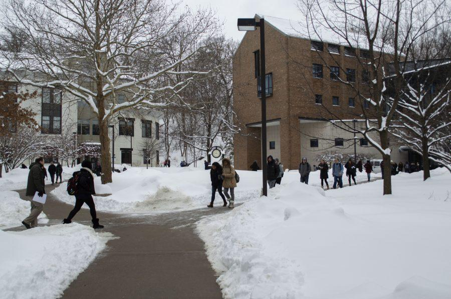 Students on the quad between Olin and Hanson walk to class in freezing temperatures. Photo by Emma Gannaway/Observer Staff.