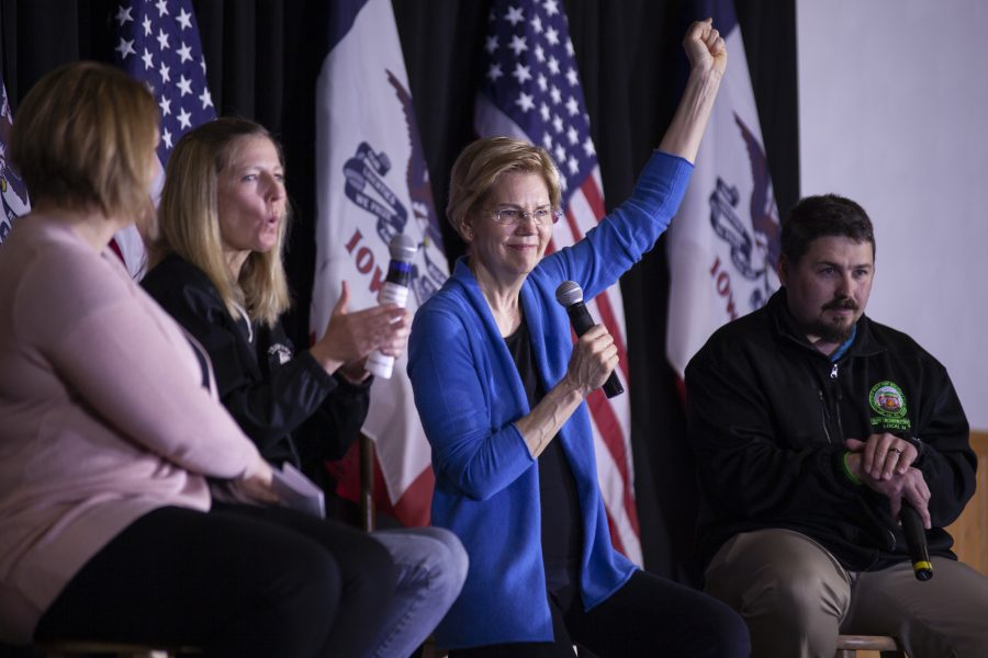 Senator Elizabeth Warren raises her fist during the Davenport Roundtable talk at the Mississippi Valley Fairgrounds. Warren spoke with the Teamster 238 group and answered questions from the crowd. Photo by Kevin Donovan