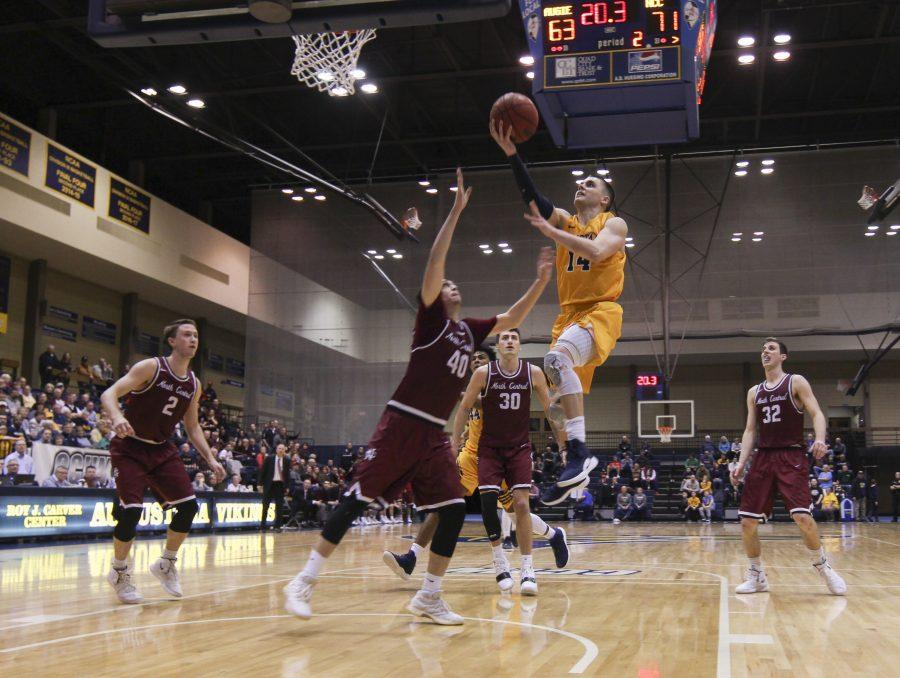 Augustana Senior Nolan Ebel jumps for a layup during Saturdays CCIW Tournament Championship game in the Carver Center. Photo by Kevin Donovan