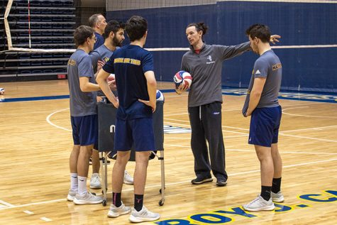 Augustana Vikings Interim Head Coach, Joshua Zolecki, coaches and speaks with the Men's Volleyball team at their Carver Gym practice.