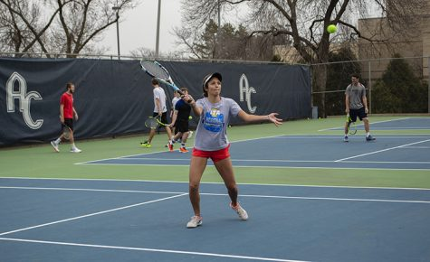 Sophomore Morgan Bullen goes to return the ball at the team's practice on Thursday, March 28 whilre preparing for their matches against Illinois Insitute of Technology and Coe College on Saturday, March 31. Photo by Emma Gannaway.