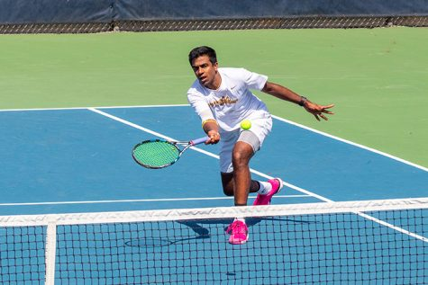 Augustana Sophomore Sriram Sugumaran, bumps the ball over the net at the Augustana Vikings match against the North Central College Cardinals at the Augustana College Tennis Courts. April 6, 2019. Photo by Ian Murrin.