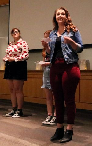 Senior, MJ Mason, delivers a line of a monologue titled My Short Skirt with fellow members of the Vagina Monologues.