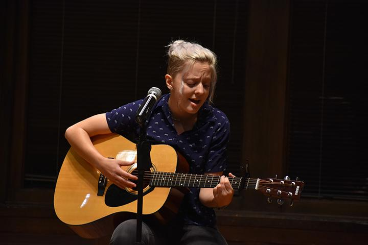 Augustana College Junior Eva Harvin plays a song onstage on September 20th, 2019. Photo by Chris Ferman.