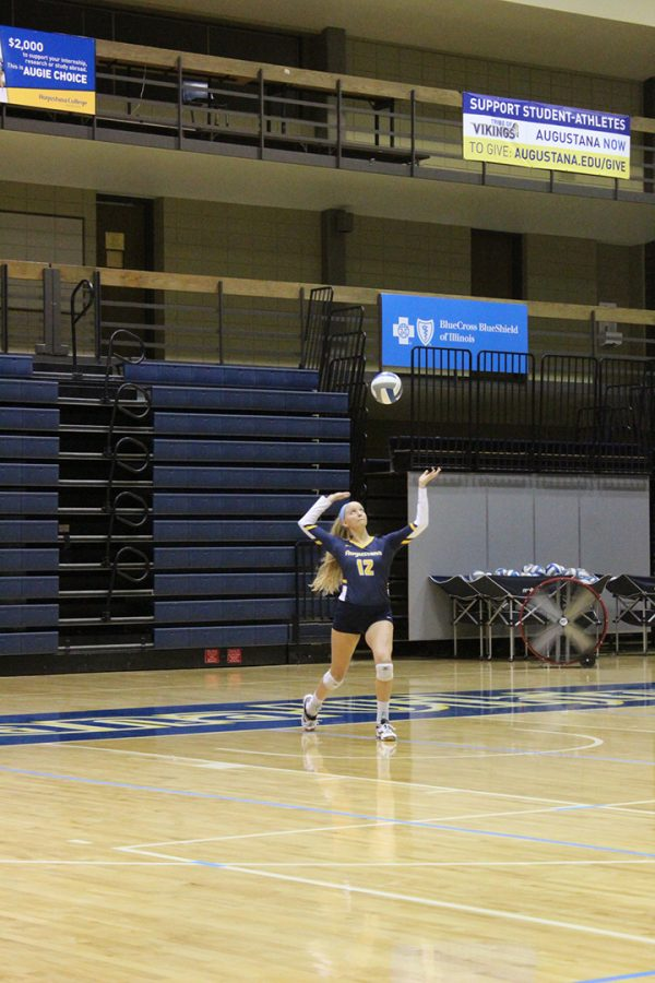 Augustana sophomore Brooke Harmon serves the first ball of the game against the Carroll University Pioneers in the Roy J. Carver Center for Physical Education on September 25, 2019. Augustana won all three matches (26-24, 25-17, 25-15).