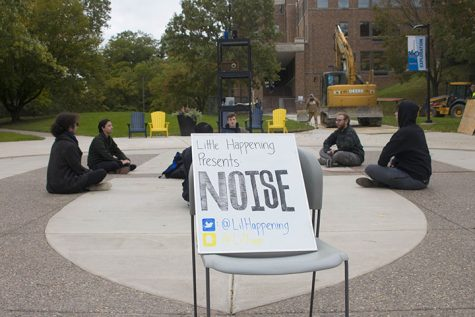 Augie senior Jonathan Quigley, Freshman Blake Traylor, and Juniors Tyler Bentley, John Cunningham, (left to right), surrounding the speakers playing random noises during the noise event organised by Little Happenings.
