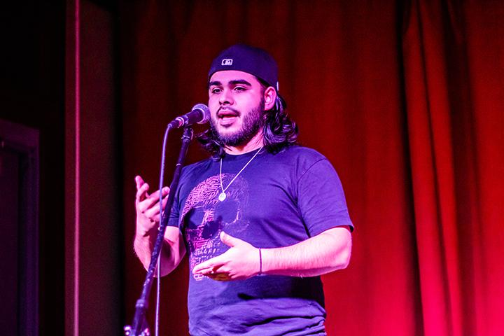 Augustana alumni and Chicago resident, Uxmar Torres, 24, recites his written poems at the Roaring Rhetoric Fundraiser sponsored by the 2F Project for Community Education at Rozz-Tox on October 5, 2019. Torres uses his experiences of growing up in Chicago to create honest and conflict charged poetry.