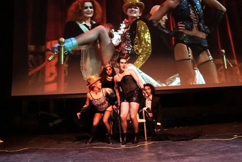 Augustana sophomore Mary Sales (from left), juniors Cassie Karn and James wheeler and senior Jonathan Quigley pose at Frank N' Furter's throne during The Rocky Horror Picture Show Shadowcast at the Augustana College Brunner Theater Center on October 24, 2019.