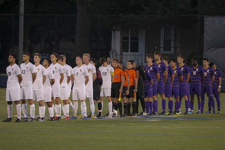 Players lining up and paying respect to the national anthem before the start of the game (Augustana vs. Knox) on Tuesday, Sept 24.