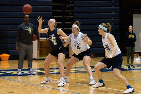 Augustana sophomore Olivia Hagerty, sophomore Cassie Kruse, and senior Jeni Crain practice their team drill during during the womens basketball practice in Carver on November 4, 2019.