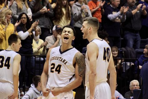 Seniors, Pierson Wofford (left) and Roman Youngblut (right) scream in happiness after their big win Senior, Micah Martin, for the Augustana Men's Basketball team goes up for the backwards grab in their game against the Calvin Knights on November 16, 2019 in the Roy J. Carver Center for Physical Education. The Vikings won the game 70-67.
