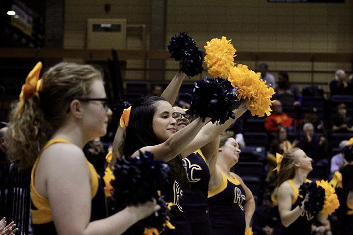 Augustana+Cheer+Squad+pictured+cheering+on+the+men%E2%80%99s+basketball+game+Sophomore+Michelle+Quinn%2C+a+member+of+the+Augustana+Cheer+Squad%2C+cheers+loud+and+proud+for+the+men%E2%80%99s+basketball+game+against+the+Calvin+Knights+on+November+16%2C+2019+in+the+Roy+J.+Carver+Center+for+Physical+Education.+The+Vikings+won+the+game+70-67.