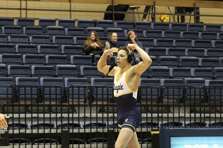 174 lb senior Josh Bush pinned John Marsh of Cornell at a time of  1:34 and flexed in celebration at the Roy J. Carver Center on Wednesday February 19, 2020.