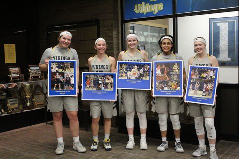 Seniors (left to right) Maddy Murillo, Jeni Crain, Mia Lambert, Alexis Jones, and Emily Ness lined up for some pictures with their photo boards after defeating North Park 62-56 at Roy J. Carver on February 22, 2020.