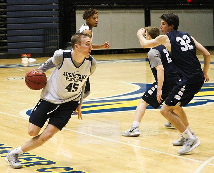 Augie Junior Carson Frakes dribbling the ball past players during practice on February 27, 2020 at Roy.J.Carver center.