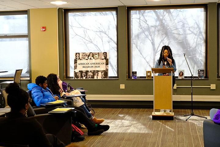 Ashley Allen, Assistant Director of the Office of Student Inclusion and Diversity, reads at the African American Read In on Friday.