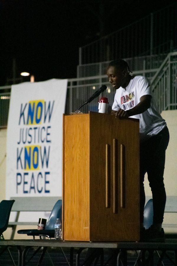 Augustana Senior Jacob Washington speaks at the Vigil for Lives Lost at Ericson Field on Thursday, September 24, 2020. Photo by Chris Ferman.