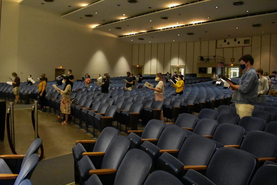 Augustana's choir group spread out to remain socially distant during practice at Centennial Hall on Thursday, October 8th, 2020. Photo by Chris Ferman.