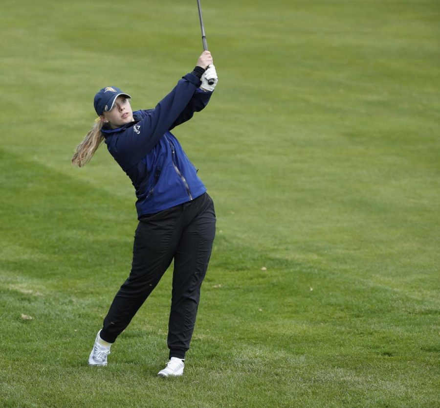 Junior Grace Loverde takes a swing during competition last year. Photo credits belong to the Augustana Athletic Department.