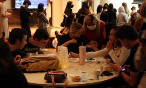 A group of students enjoy the food and atmosphere at the Moonlight Festival in Wallenberg Hall on Friday, Sept. 24.