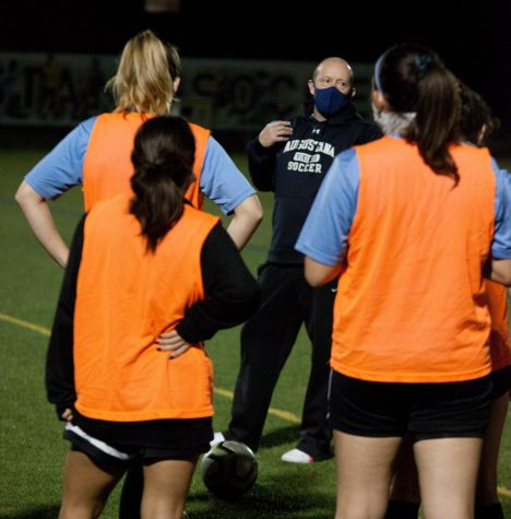 Womens soccer coach Scott Mejia explains a drill at the beginning of practice at Thorson-Lucken Field on Wednesday, Oct. 14, 2020.