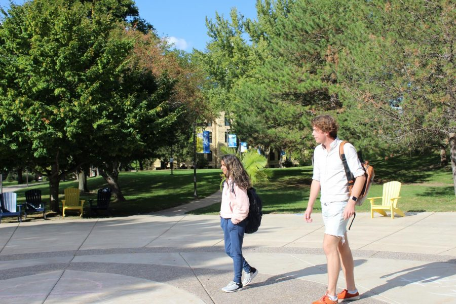 Sophomore Pooja Mehr walks towards Olin after her art 211 class on Sept. 22 on the quad. She walks with her classmate Erik Pattersson.