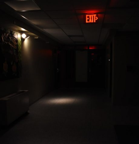 Emergency lights light up the hallway of Erickson Hall during the outage.